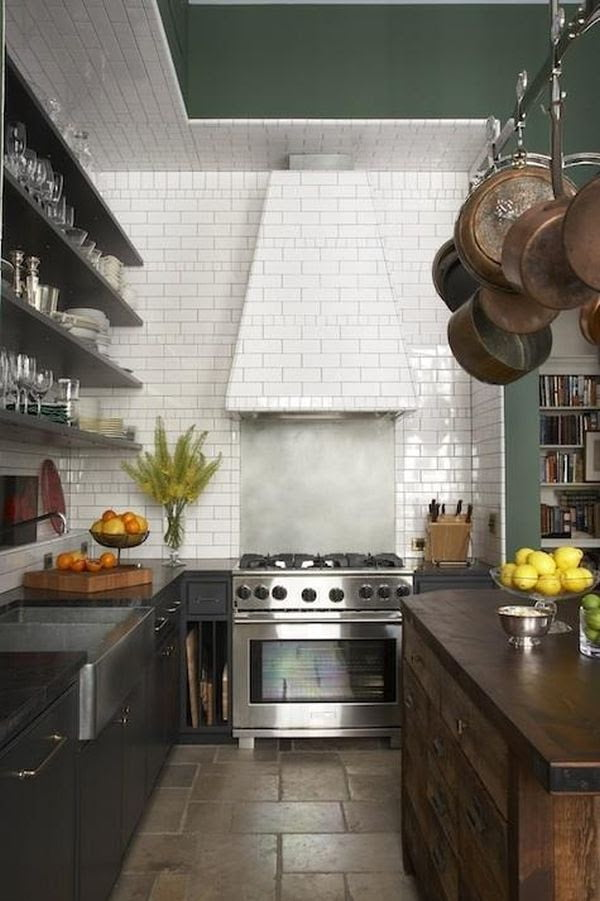 You can extend the tiles onto the ceiling and even onto the kitchen hood