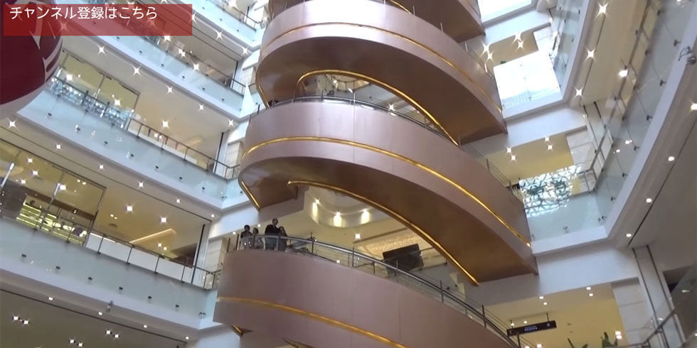 largest spiral escalator mitsubishi ever built in shanghai