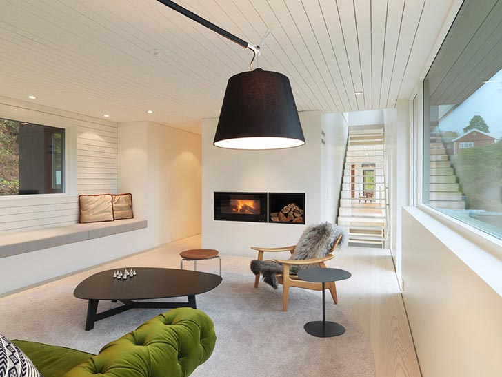 3 Stacking Elements Clad In Stained Dark Wood In Norway