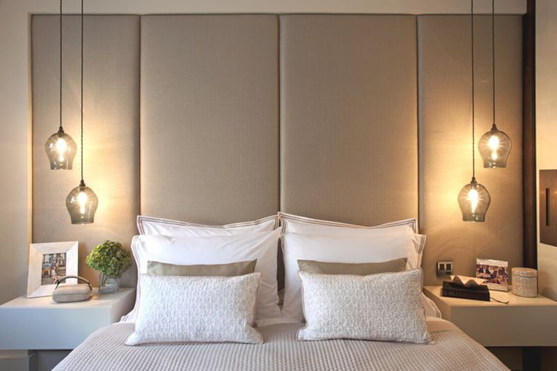bedroom decoration with pendent lights on sidetable