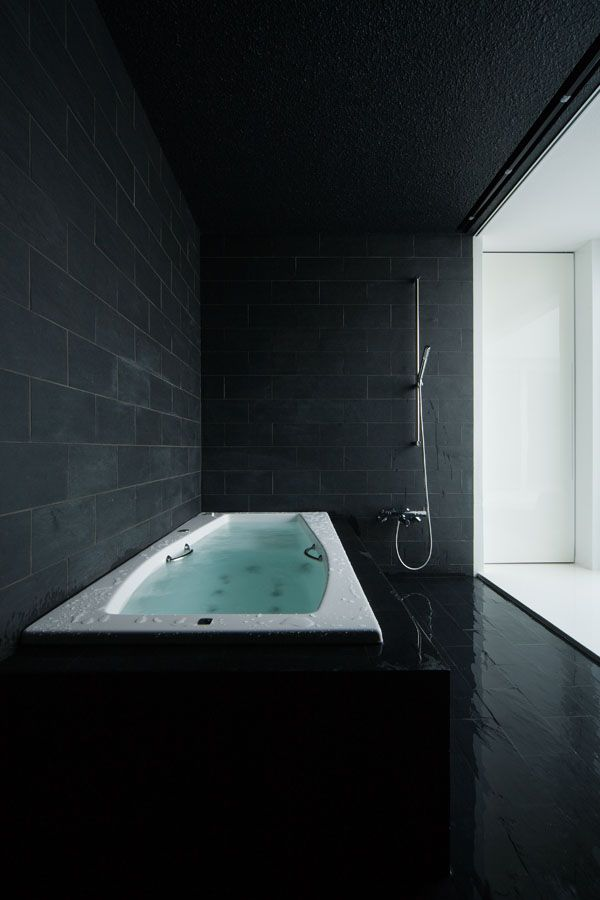 black and white bathroom is from a home in Shiga, Japan, designed by FORM - Kouichi Kimura Architects