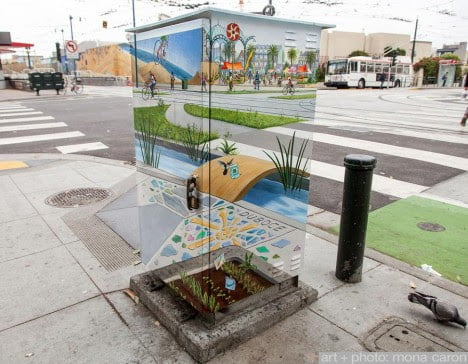 artist Mona Caron's Manifestation Station junction box projects a visionary streetscape