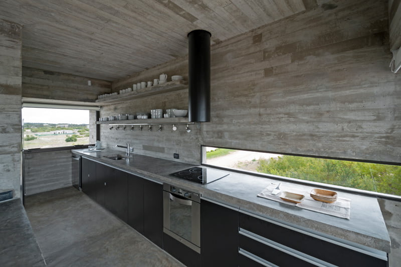 exposed concrete modern house kitchen with modern cabinate