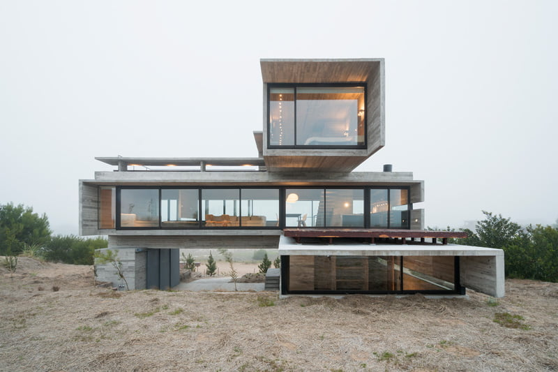 exposed concrete modern house with golfcourse view front elevation