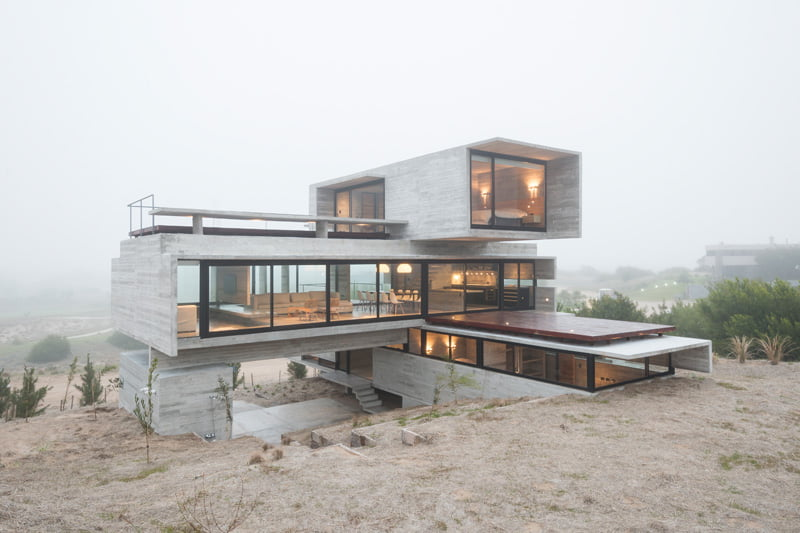 exposed concrete modern house with golfcourse view with living deck