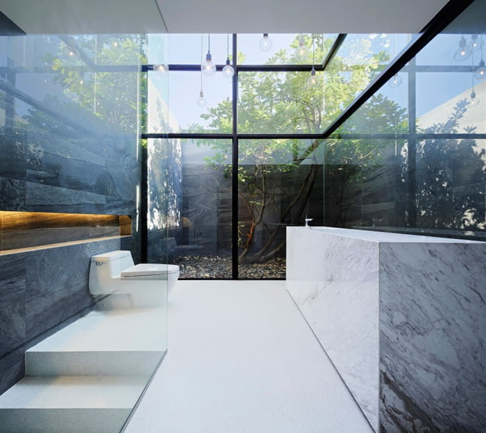 Modern bathroom facing towards internal coutyard as a main design element of house design