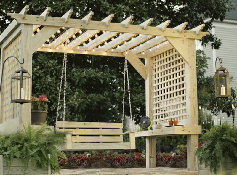 garden wooden pergola with swing in it