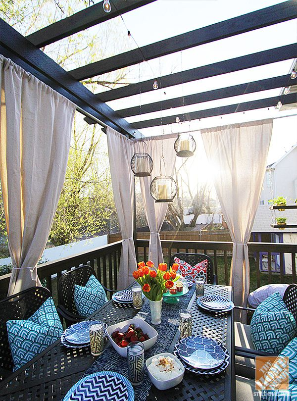 image of wooden pergola with curtain clad