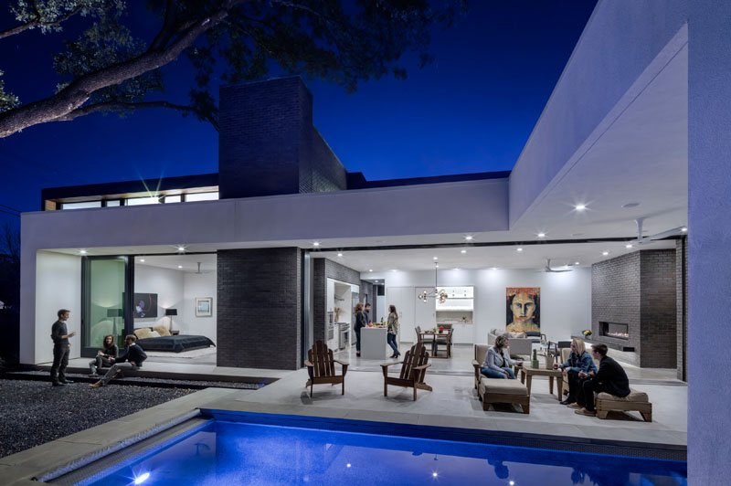 Pool side cool lighting on deck area in modern house
