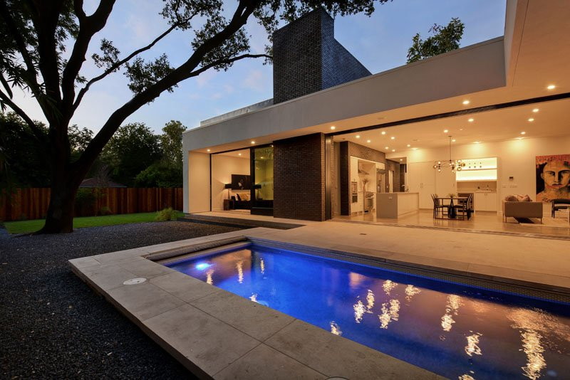 contemporary house design with pool facing living space