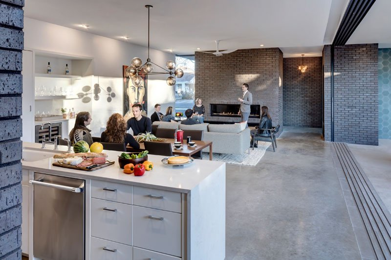 exposed brick touch with white finished wall in home interior