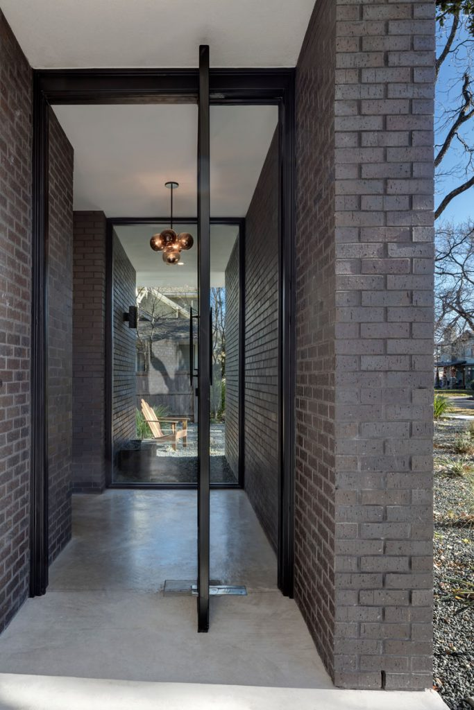 indirect entrance area with rivolving glass door