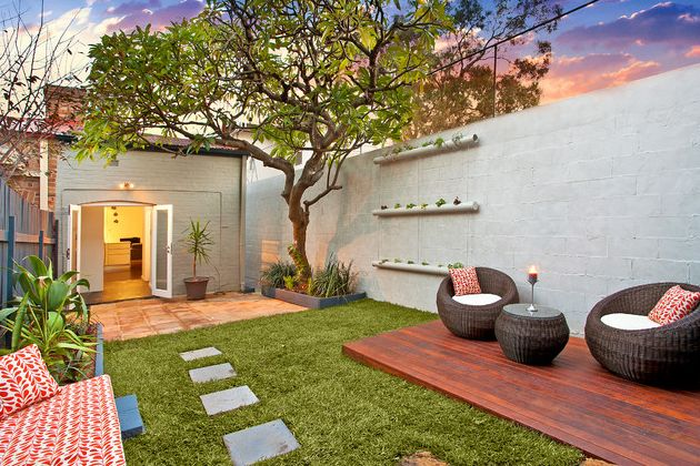 Combine outdoor deck materials with green lawn and concrete pavers