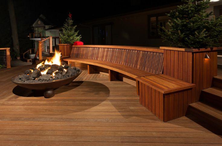 Outdoor deck design around fire pit and circular wooden bench ideas