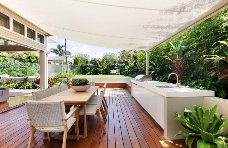 Outdoor wooden deck with kitchen design in modern design touch
