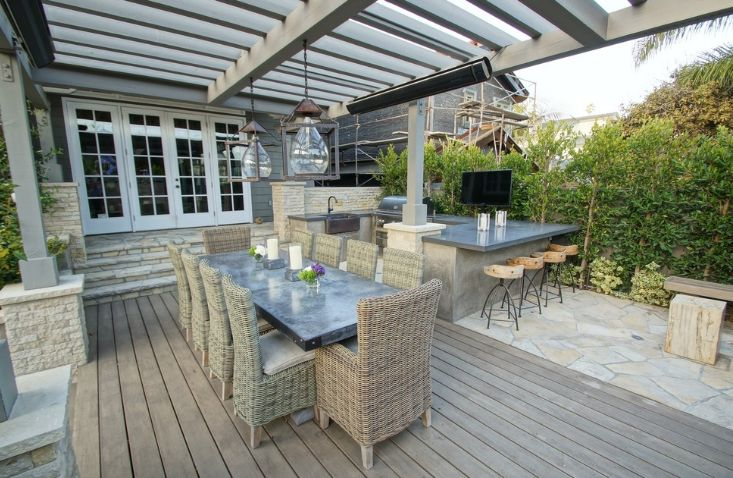 Traditional outdoor deck with wooden pergola and hanging lights