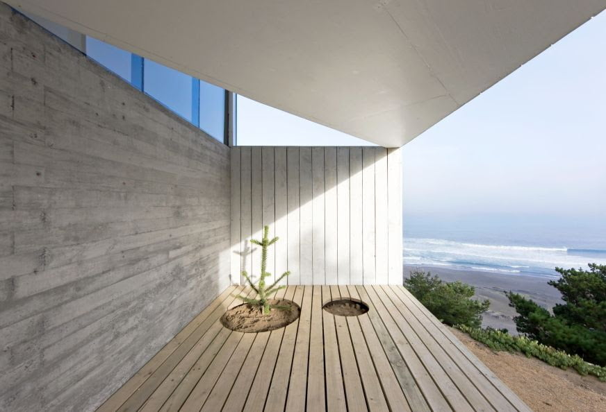 architectural design of deck in cube home with sea side view