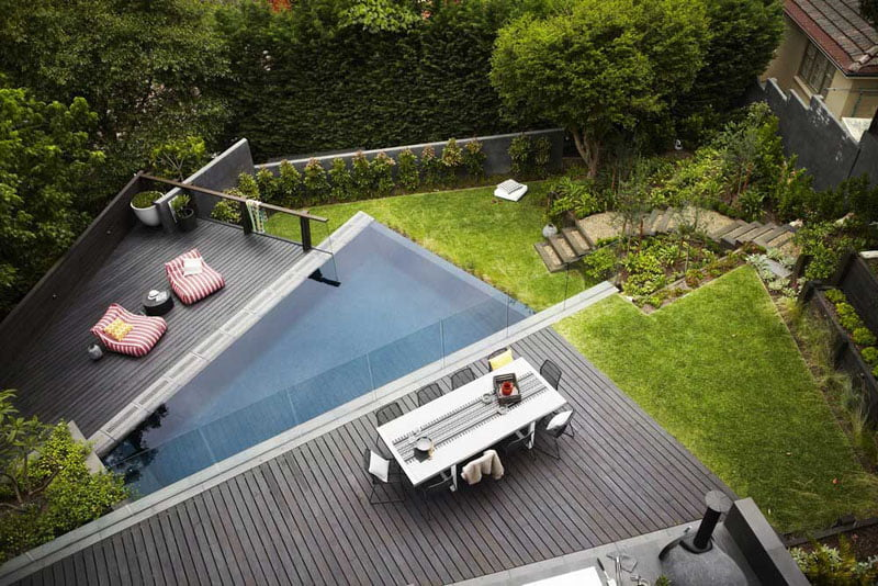 backyard landscaping ideas with tiered level with pool and family sitting