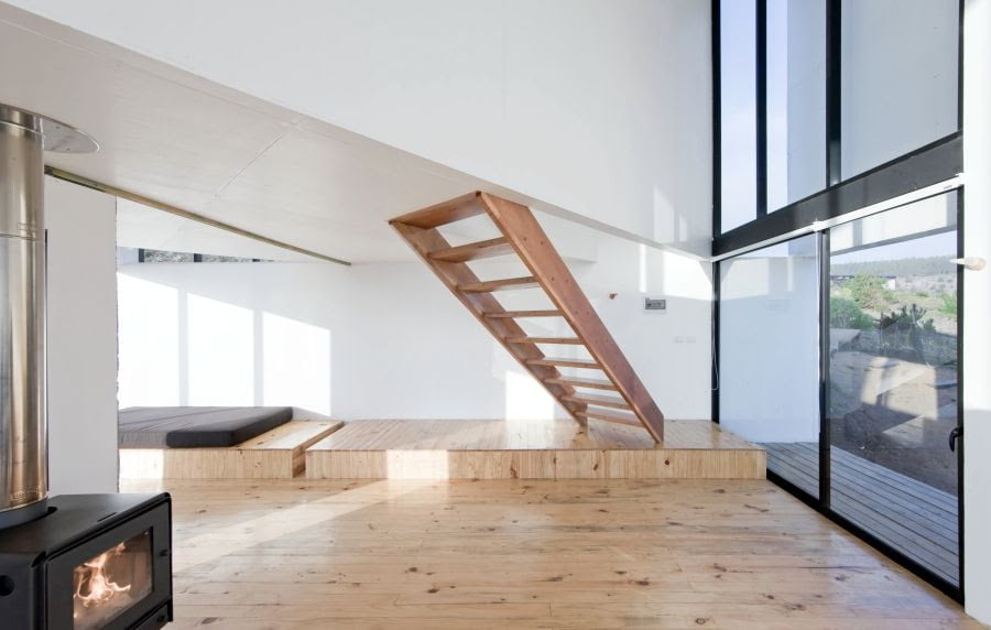 double height volume with floating wooden stair in cube home