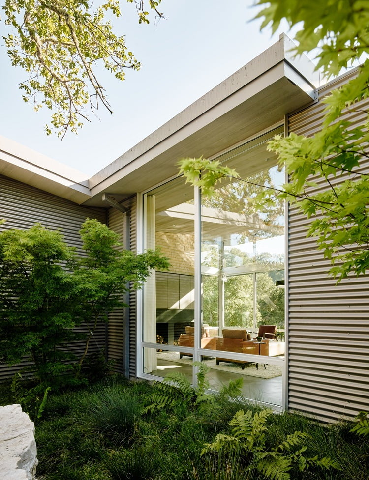 Overhangs around the perimeter of weekend retreat help prevent interior heat buildup and glare