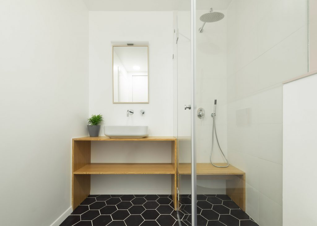 Black and White Bathroom with shower Cube for apartment interior design.
