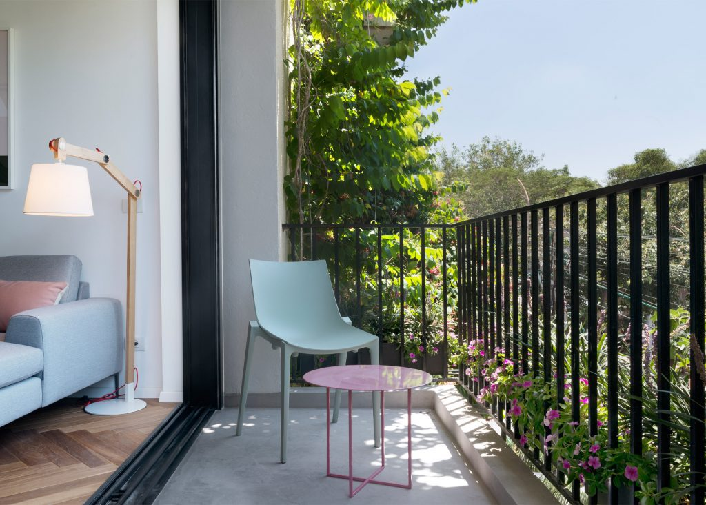 Small Balcony seating and railing design idea in apartment decor.