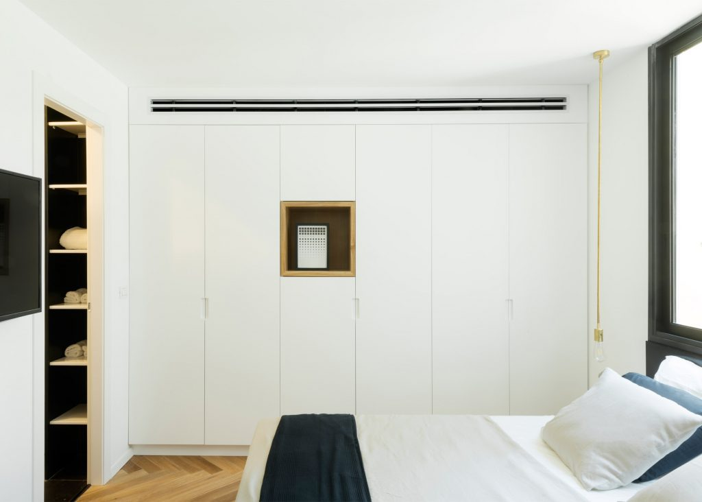 White Bedroom wardrobe Ideas for Contemporary Apartment Interior.